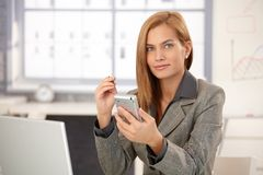 Portrait of businesswoman with PDA Stock Image