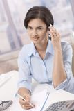 Portrait of businesswoman on phone call Royalty Free Stock Images