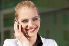 Portrait of businesswoman at phone Stock Image