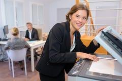 Portrait businesswoman at photocopier. Portrait of businesswoman at photocopier Stock Image