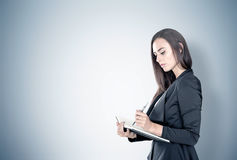 Portrait of a businesswoman with planner, gray Royalty Free Stock Images