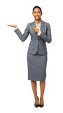 Portrait Of Businesswoman Pointing At Invisible Product Stock Photo