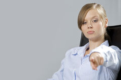 Portrait of businesswoman pointing in office Royalty Free Stock Images