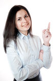 Portrait of businesswoman pointing upwards. Stock Image