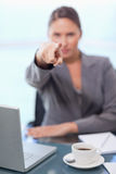 Portrait of a businesswoman pointing at the viewer Royalty Free Stock Images
