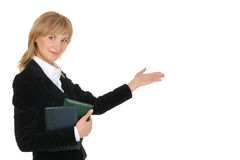 Portrait of businesswoman  pointing at wall . Royalty Free Stock Photo