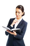 Portrait of businesswoman reading her notes Royalty Free Stock Photos