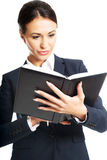 Portrait of businesswoman reading her notes Stock Photos