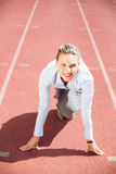 Portrait of businesswoman in ready to run position Royalty Free Stock Photos