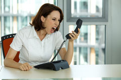 Portrait of businesswoman screaming Stock Images