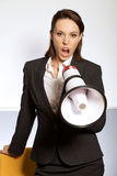 Portrait of businesswoman shouting through megaphone Royalty Free Stock Photo