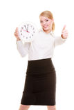 Portrait businesswoman showing clock and thumb up. Time. Stock Photos