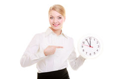 Portrait businesswoman showing clock. Time. Royalty Free Stock Image