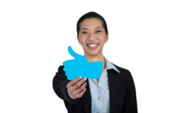 Portrait of businesswoman showing thumbs up sign board Stock Image