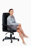 Portrait of a businesswoman sitting on an armchair Stock Image