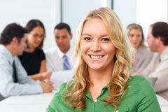 Portrait Of Businesswoman Sitting At Boardroom Table Stock Photo