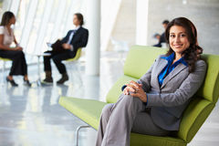 Portrait Of Businesswoman Sitting On Sofa In Modern Office. Relaxing Royalty Free Stock Photo