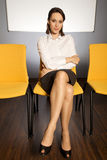 Portrait of businesswoman sitting in waiting room Royalty Free Stock Photography
