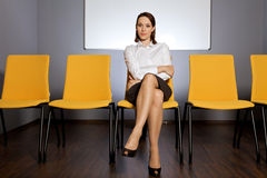 Portrait of businesswoman sitting in waiting room Stock Photos