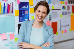Portrait of businesswoman smiling with arms crossed Stock Image