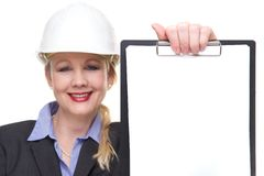 Portrait of a businesswoman smiling and holding blank clipboard isolated Royalty Free Stock Photo