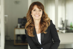 Portrait of a businesswoman smiling. Stock Photos