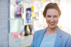 Portrait of businesswoman smiling Stock Image