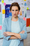 Portrait of businesswoman standing with arms crossed Stock Images