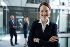 Portrait of businesswoman standing with arms crossed Stock Image