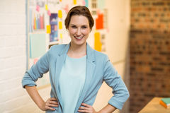 Portrait of businesswoman standing with hands on hips Stock Photos