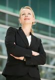 Portrait of a businesswoman standing outside offic Stock Photos
