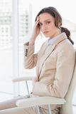 Portrait of businesswoman suffering from headache in office Royalty Free Stock Photography
