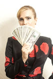 Portrait businesswoman in suit with dollars. In her hand Royalty Free Stock Photos