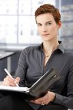Portrait of businesswoman taking notes Royalty Free Stock Image