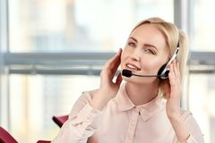Portrait of businesswoman talking on the headset phone. stock image