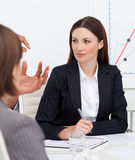 Portrait of a businesswoman talking with her team Stock Images