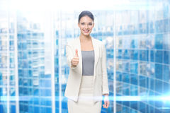 Portrait of businesswoman thumbing up Stock Photo