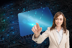 Portrait of businesswoman touching invisible screen Royalty Free Stock Photography