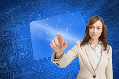 Portrait of businesswoman touching invisible screen Stock Image
