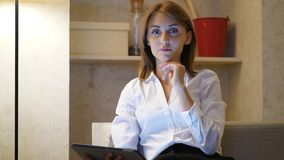 Portrait of businesswoman with touchpad at home, look in camera stock video