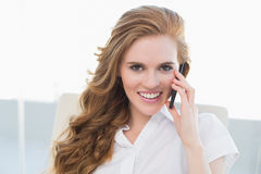 Portrait of businesswoman using cellphone in office Royalty Free Stock Photo