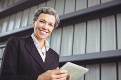 Portrait of businesswoman using digital tablet Royalty Free Stock Image