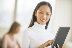 Portrait Of Businesswoman Using Digital Tablet In Office Royalty Free Stock Photos