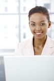 Portrait of businesswoman using laptop Royalty Free Stock Image