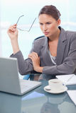Portrait of a businesswoman using a laptop Stock Photography