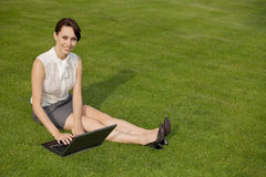 Portrait of a businesswoman using laptop Royalty Free Stock Photos