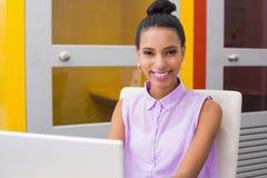 Portrait of businesswoman using laptop Royalty Free Stock Photo