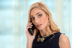 Portrait of Businesswoman Using Mobile Phone Royalty Free Stock Photography