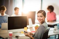 Portrait of businesswoman using mobile phone Stock Photo