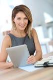Portrait of businesswoman using tablet Stock Photos